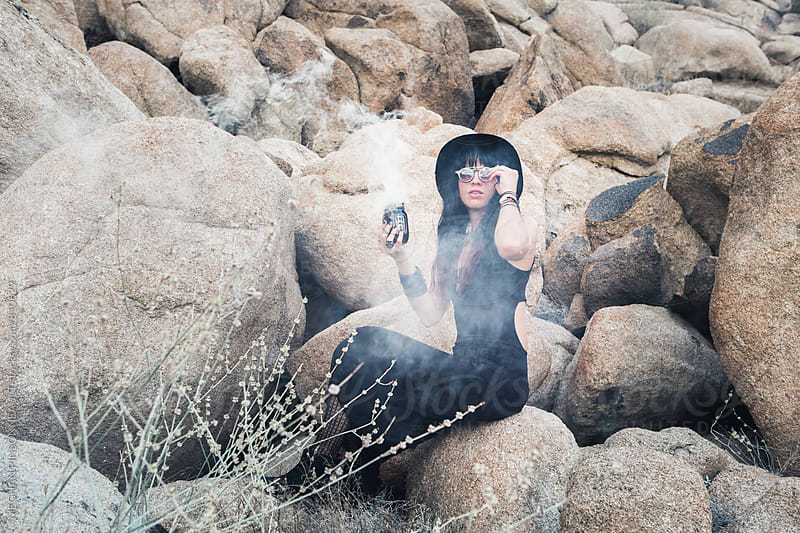 Witchy Woman with White Smoke and Desert Rocks by MEGHAN PINSONNEAULT for Stocksy United