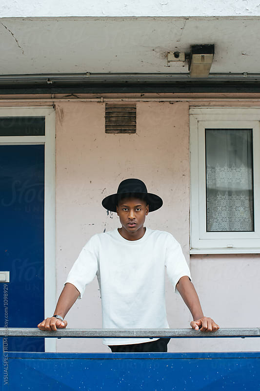 London Street Style - Cool Young Fashionable Black Man Posing in by Julien L. Balmer for Stocksy United