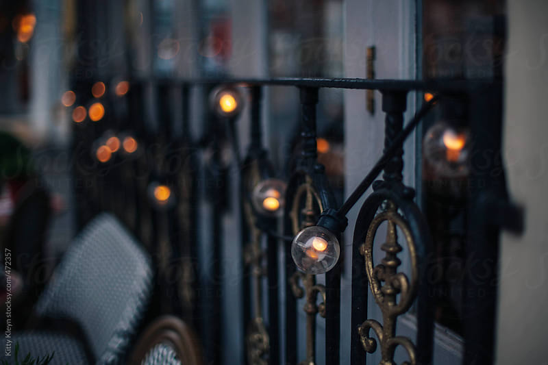 Fairy lights strung up on railings by Kitty Kleyn for Stocksy United