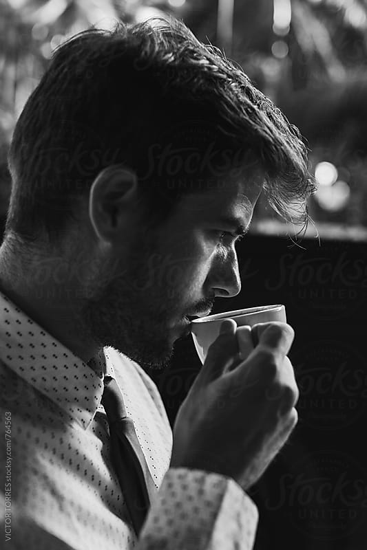Elegant Young Businessman Working in a Coffee Shop by Victor Torres for Stocksy United