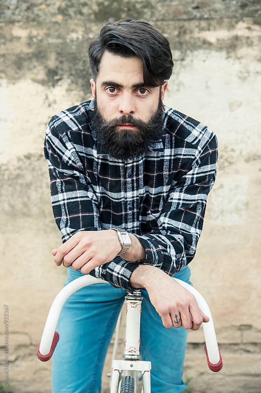 Portrait of a young man with beard by Bisual Studio for Stocksy United