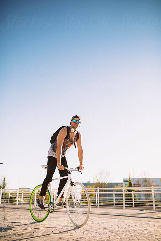 Young Man Biking in a Summer Day