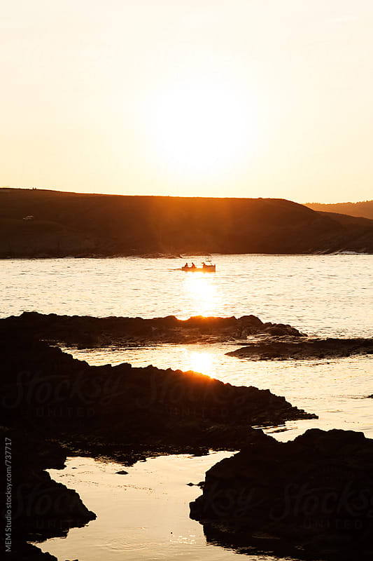 fisherman's boat on a sunset by MEM Studio for Stocksy United