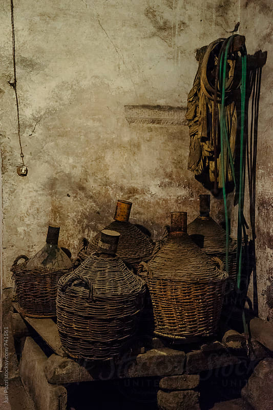 Old cellar with demijohns by Juri Pozzi for Stocksy United