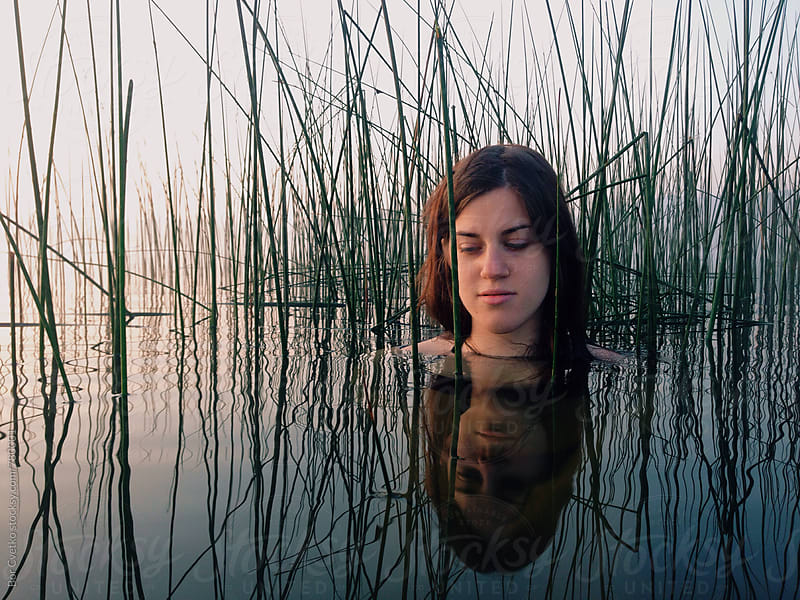 Woman in the morning lake by Bor Cvetko for Stocksy United