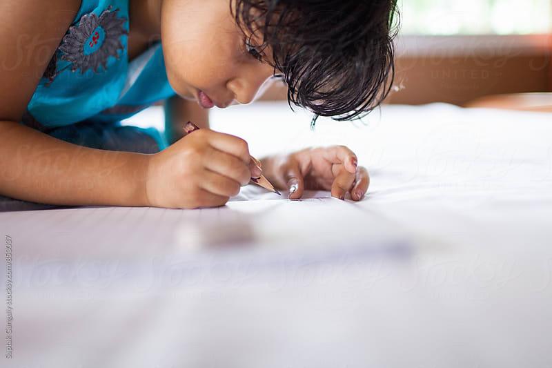 Little girl doing homework by Saptak Ganguly for Stocksy United
