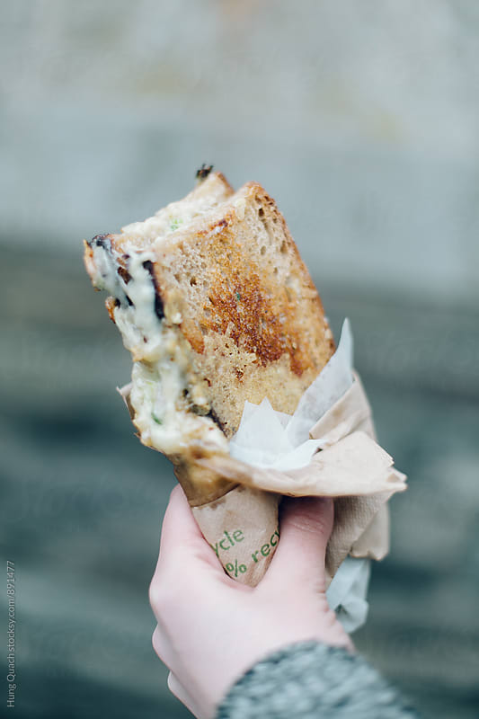 Cheese Toast Sandwich in Hand by Hung Quach for Stocksy United