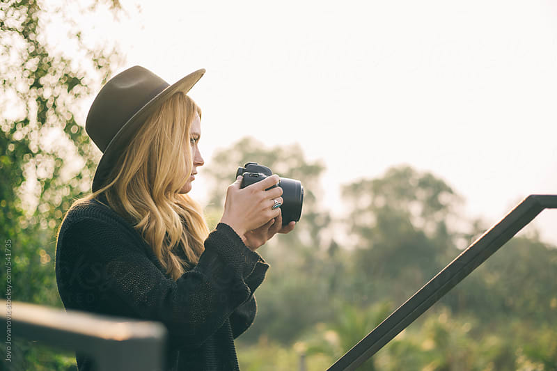 Blonde young woman taking photo of nature by Jovo Jovanovic for Stocksy United