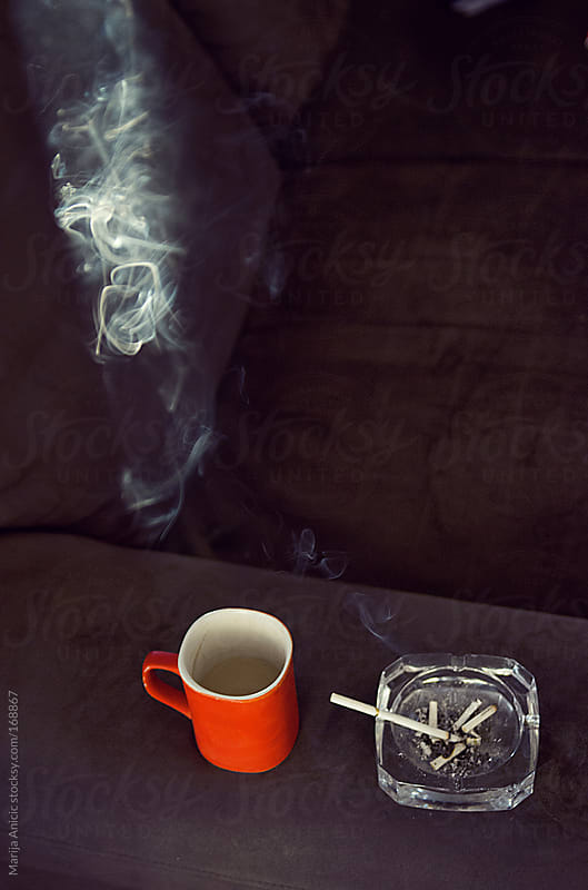 Smoke,cigarettes and red cup,various forms of smoke by Marija Anicic for Stocksy United
