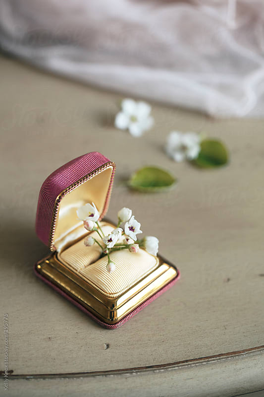 tiny flowers tucked into a vintage ring box by Kelly Knox for Stocksy United