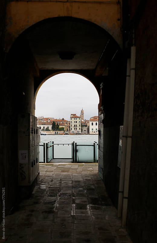 passageway with view on Venice, Italy by Rene de Haan for Stocksy United