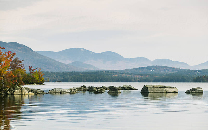 Squam Lake New Hampshire in Autumn by Raymond Forbes LLC for Stocksy United
