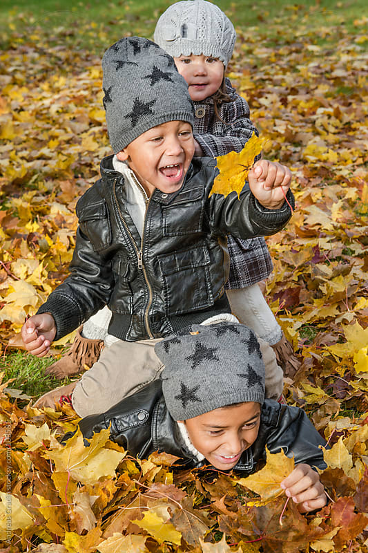 autumn family by Andreas Gradin for Stocksy United