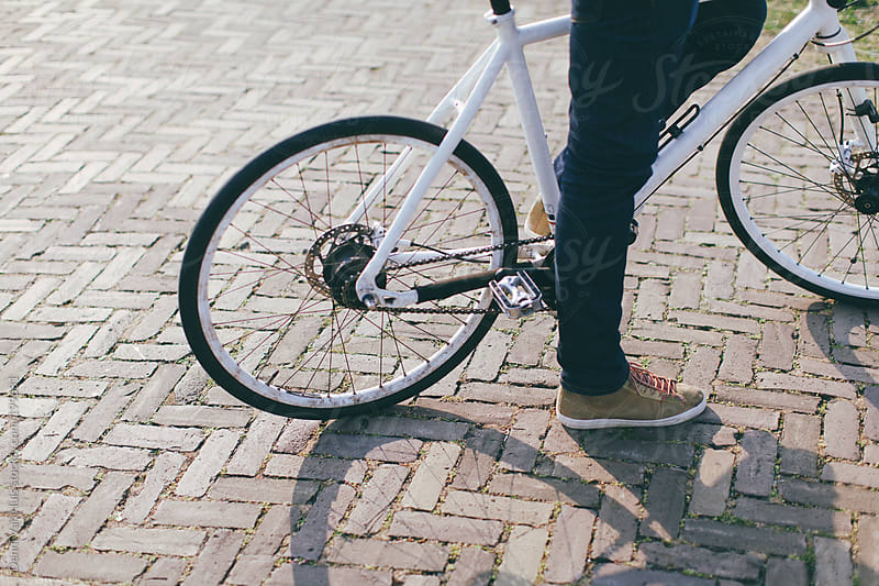 Man standing still with bicycle on path by Denni Van Huis for Stocksy United