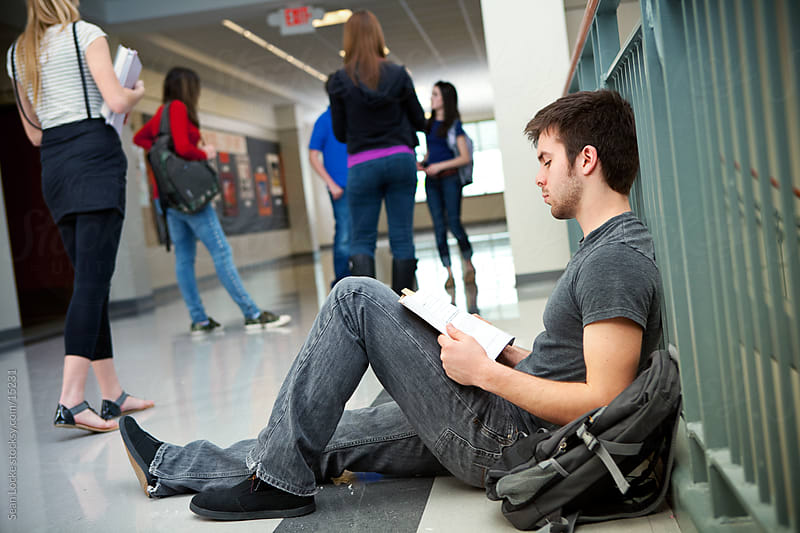 High School: Guy Sits on Floor to Review for Test by Sean Locke for Stocksy United