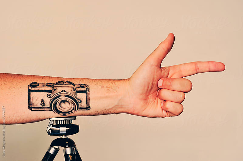 old camera tattooed  by Juan Moyano for Stocksy United