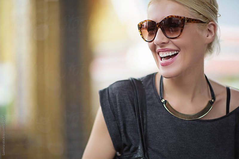 Beautiful Blonde With Sunglasses Smiling by Lumina for Stocksy United