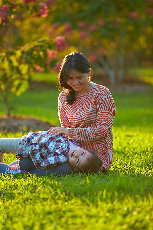 happy little girl with her mother outdoor in the sunshine park by Bo Bo for Stocksy United