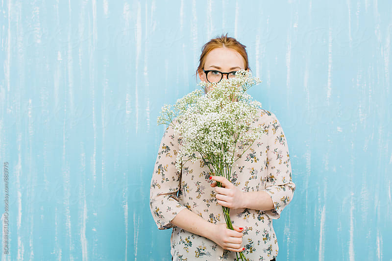 Ginger woman holding a bouquet of Paniculata flowers. by BONNINSTUDIO for Stocksy United