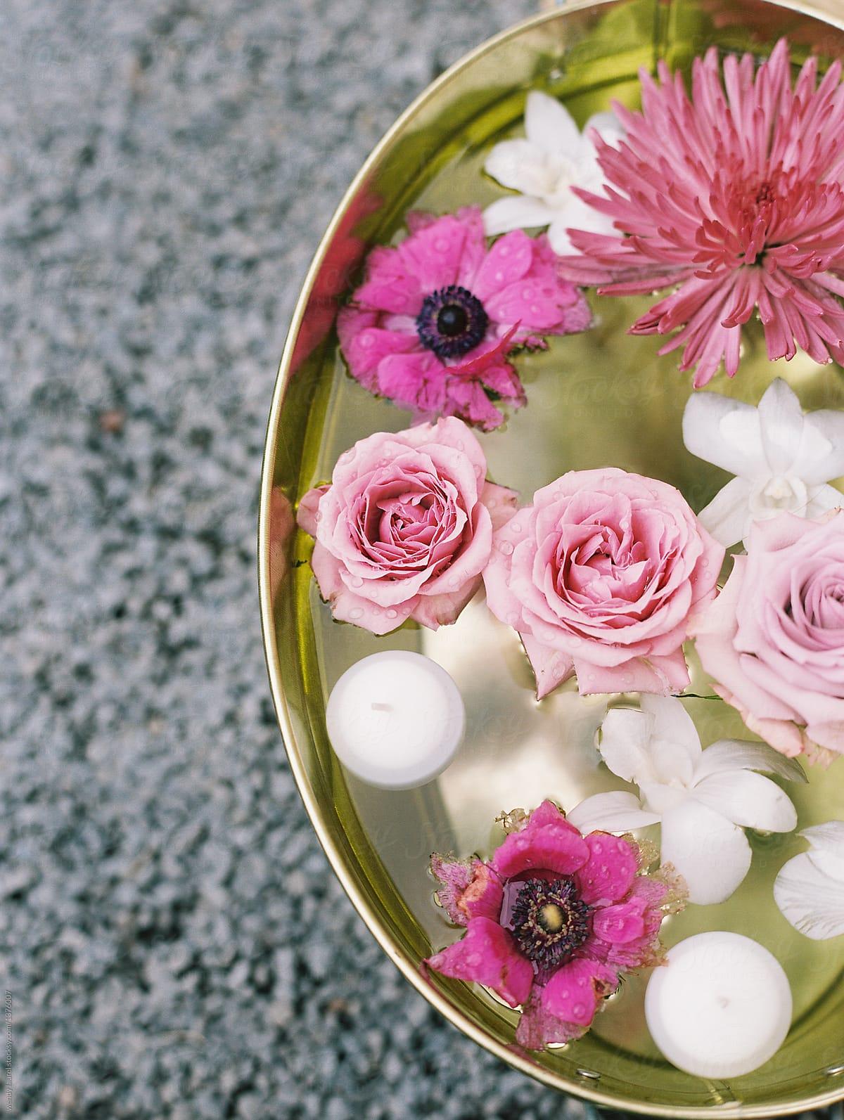 Pretty Flowers Floating In Water In Copper Bucket Stocksy United