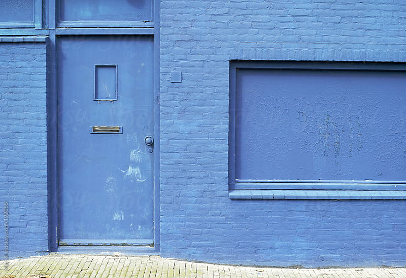 Outside of a building entirely painted blue by Marcel for Stocksy United