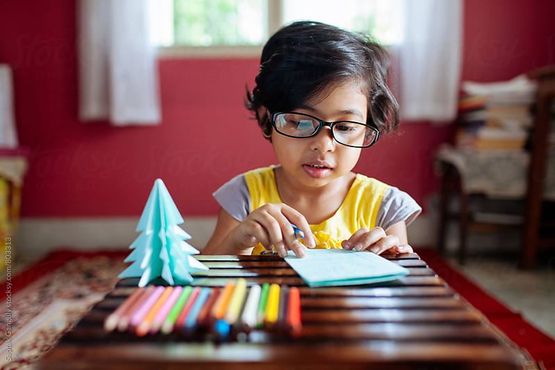 Little girl making greetings card by Saptak Ganguly for Stocksy United