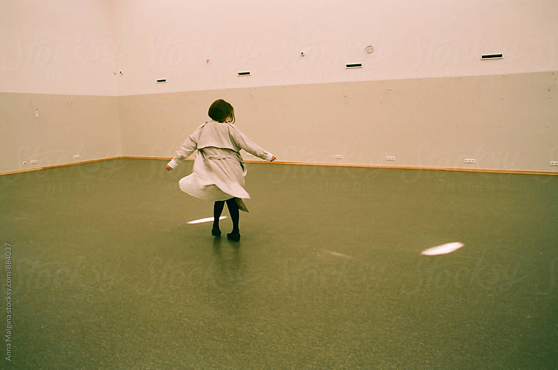 A film photo of girl dancing in the hall by Anna Malgina for Stocksy United