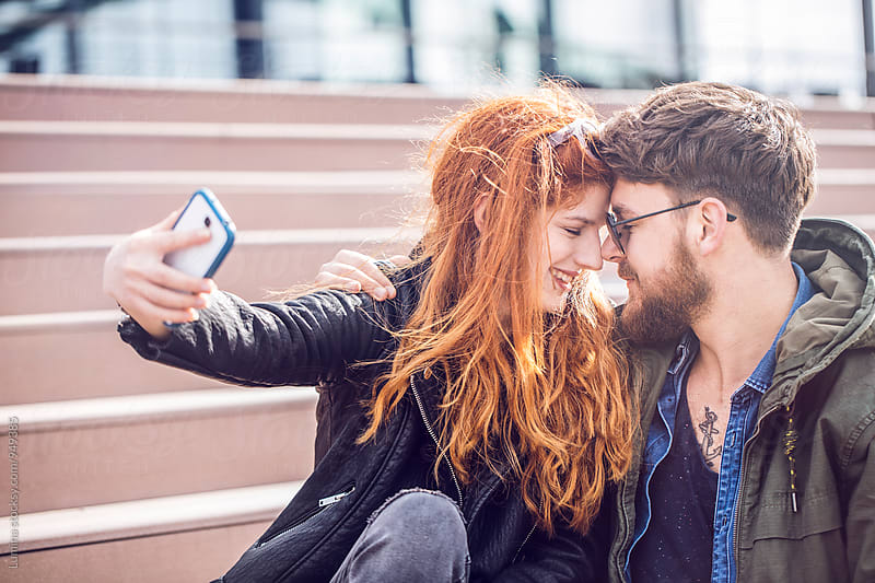 Happy Couple Taking a Selfie by Lumina for Stocksy United