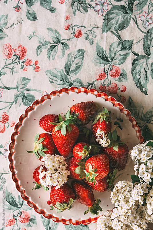 Ripe strawberries in dish by Pixel Stories for Stocksy United