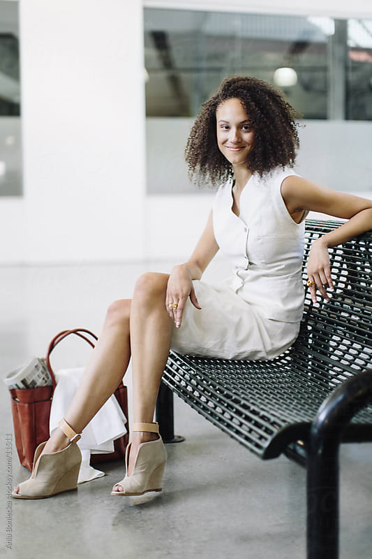 A businesswoman sitting on a bench taking a break by Ania Boniecka for Stocksy United