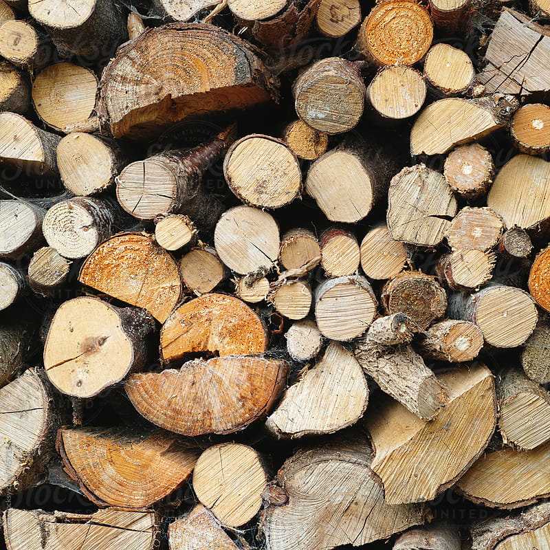 Dried firewood stack, ready for the winter by Marcel for Stocksy United