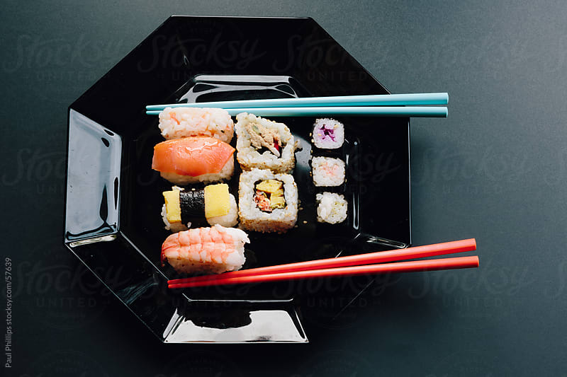 Sushi and chopsticks  by Paul Phillips for Stocksy United