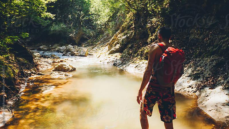 Man hiking in nature by Dimitrije Tanaskovic for Stocksy United