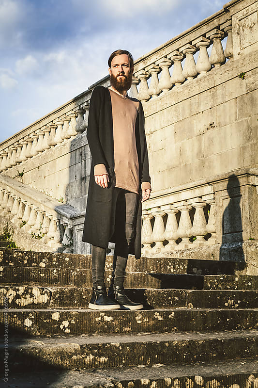 Young Man with Dark Fashion Clothes on an Old Staircase by Giorgio Magini for Stocksy United
