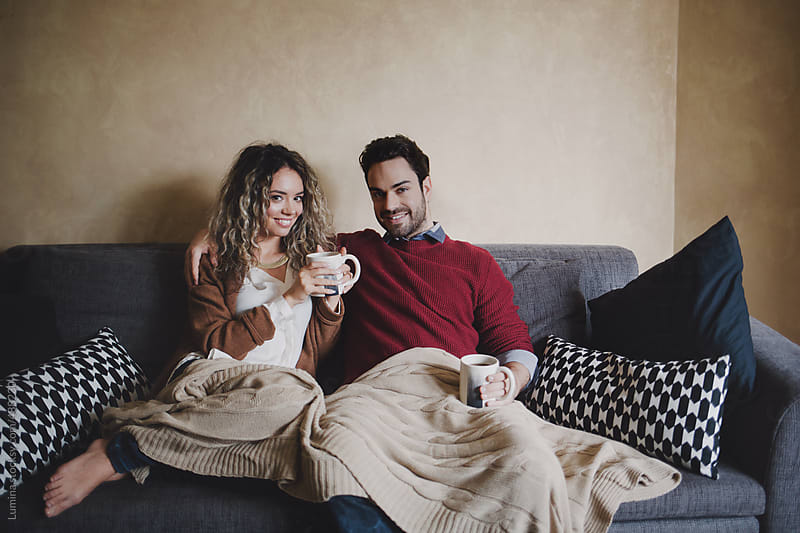 Happy Couple Drinking Tea at Home by Lumina for Stocksy United