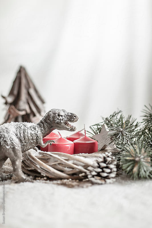 Christmas dinosaur by Susan Brooks-Dammann for Stocksy United