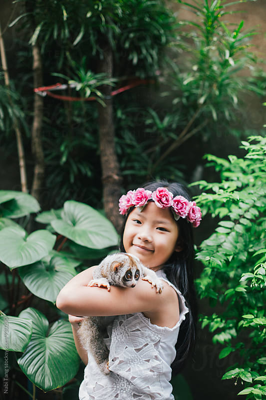 Girl portrait with slow loris in the zoo by Nabi Tang for Stocksy United