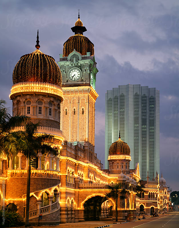 The Sultan Abdul Samad Building illuminated at night. Kuala Lumpur. Malaysia. by Hugh Sitton for Stocksy United