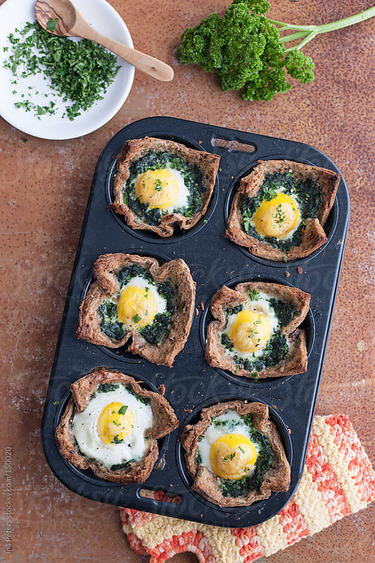 Food: Toast Muffins with Spinach and Eggs by Ina Peters for Stocksy United