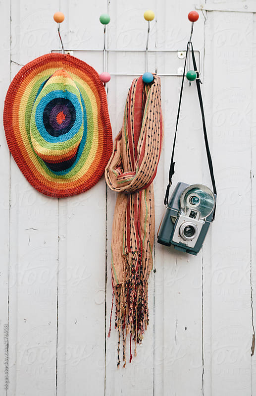 Vintage camera hanging next to scarf and hat by kkgas for Stocksy United