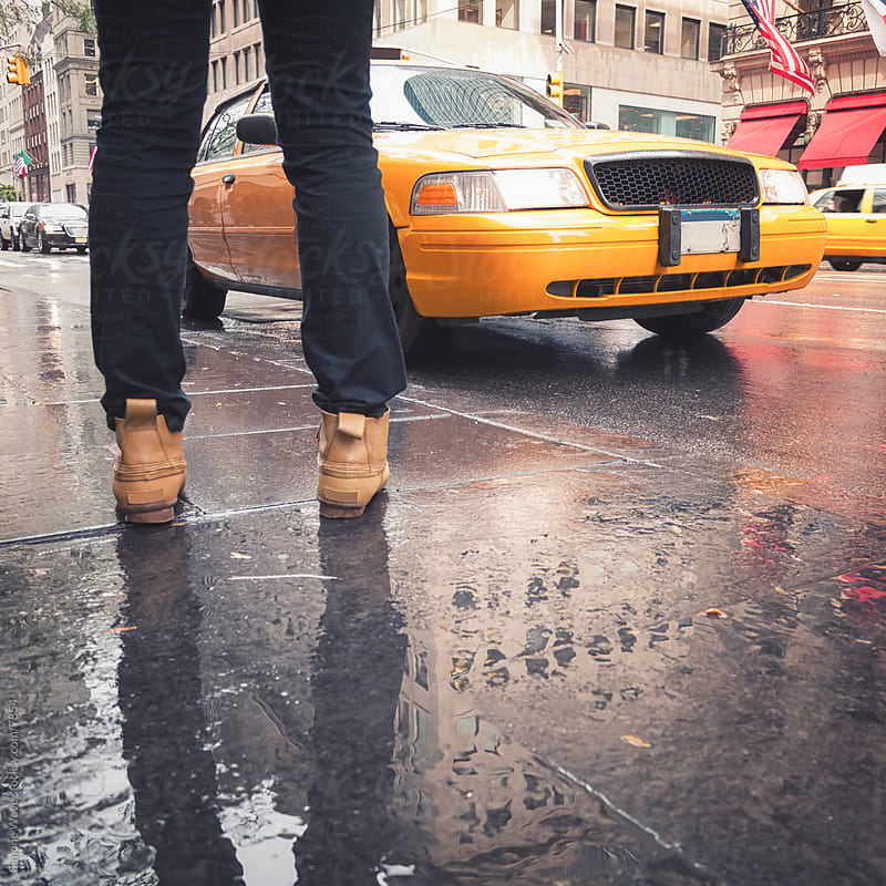 Man standing in front of a Taxi - New York City by GIC for Stocksy United