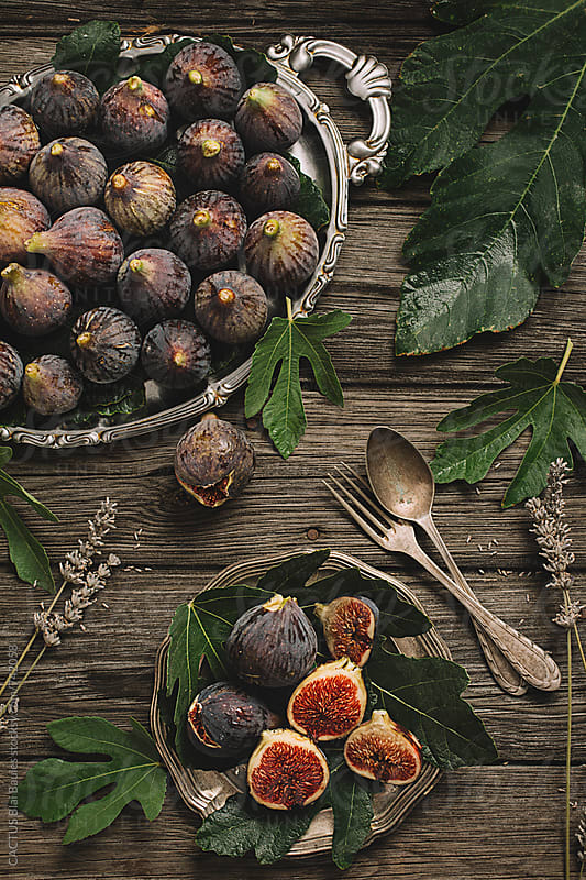 Fresh figs on wooden table by CACTUS Blai Baules for Stocksy United