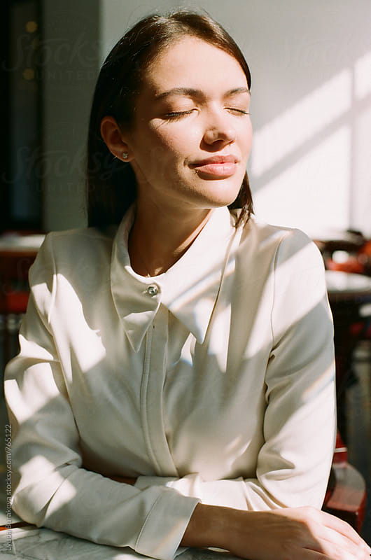 Portrait of the woman enjoys the sun by Lyuba Burakova for Stocksy United