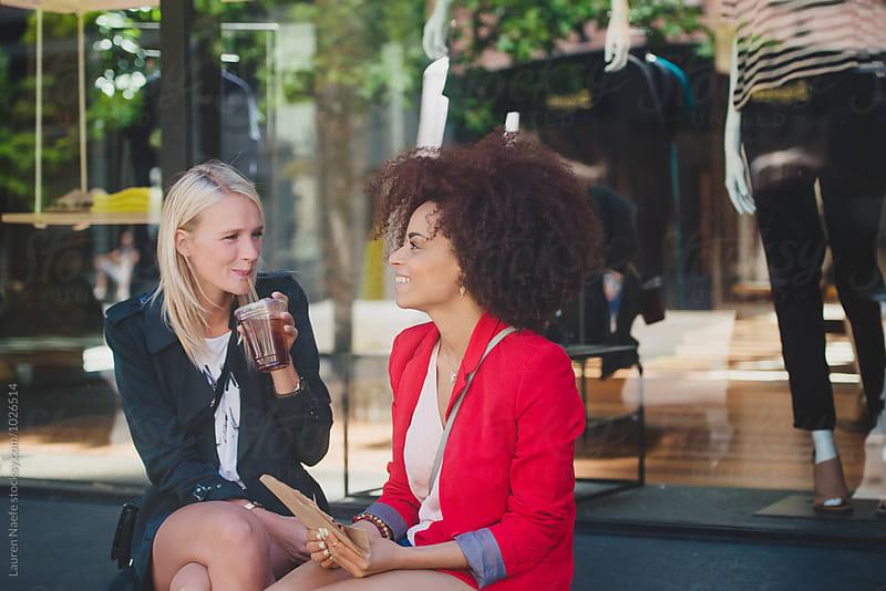 Female friends talking by Lauren Naefe for Stocksy United