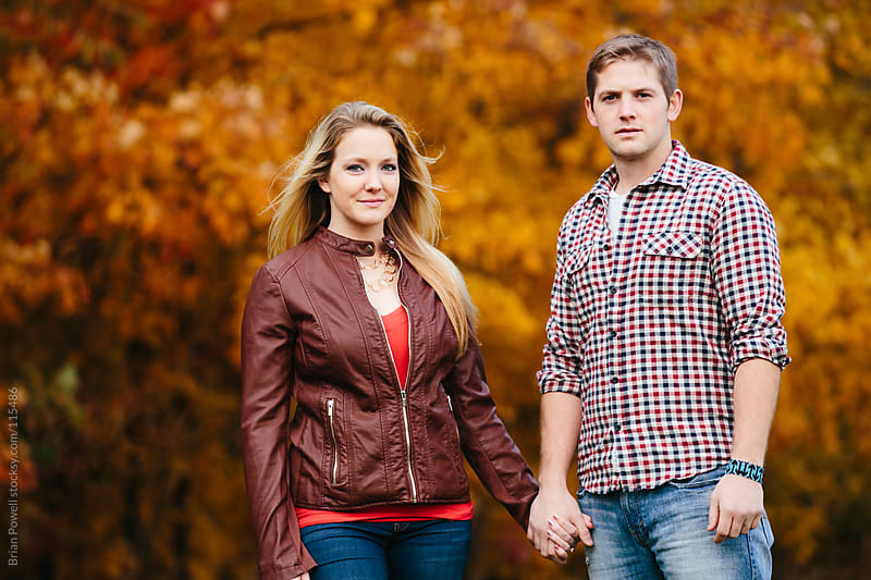 trendy young couple in the Fall by Brian Powell for Stocksy United