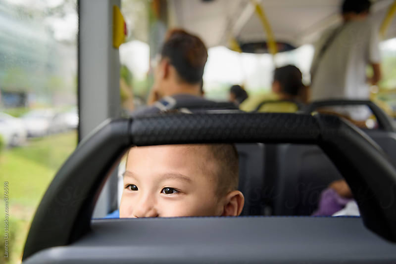 Child sitting on bus by Lawren Lu for Stocksy United