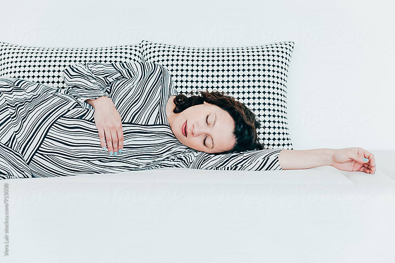 Pregnant woman sleeping by Vera Lair for Stocksy United