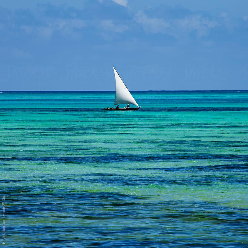 Dhow sailing along the Zanzibar coast. Zanzibar by Hugh Sitton for Stocksy United