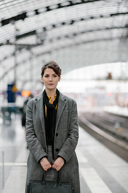 Businesswoman Waiting Fro Train by VegterFoto for Stocksy United
