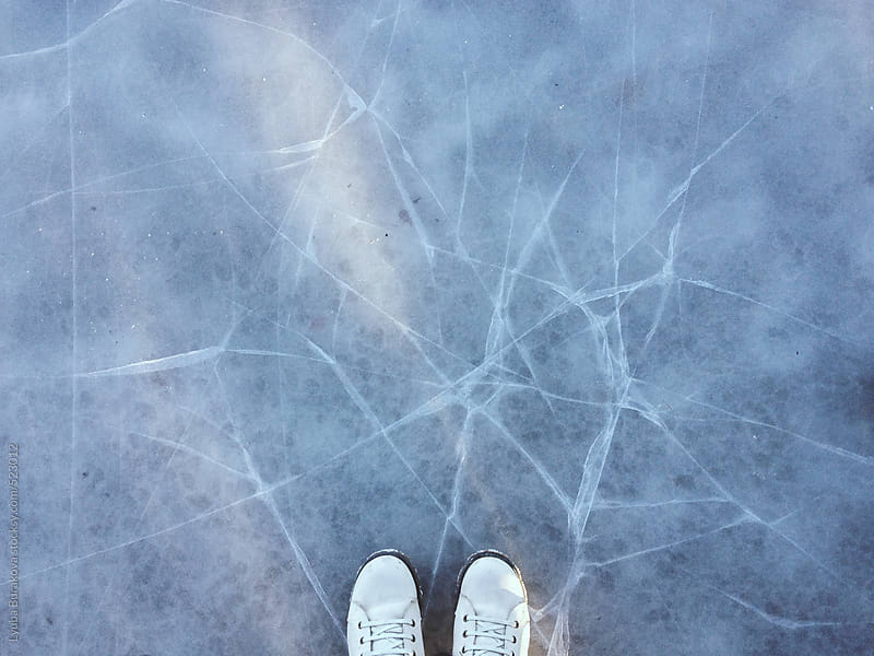 Standing on the cracking ice by Lyuba Burakova for Stocksy United